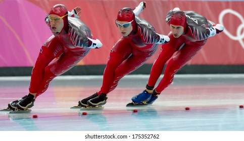 TURIN, ITALY-FEBRUARY 17, 2006: Canadian team competing on the Speed Ice Skating competition during the Winter Olympic Games of Turin 2006.