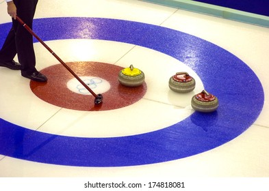 TURIN, ITALY-FEBRUARY 19, 2006: Close up of Curling stones on traget during the Winter Olympic Games of Turin 2006.