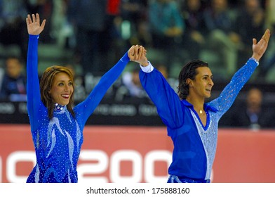 TURIN, ITALY-FEBRUARY 21, 2006: Italian Federica Faiella and Massimo Scali waving the public at the end of the Figure Ice Skating competition, at the Winter Olympic Games of Turin 2006.