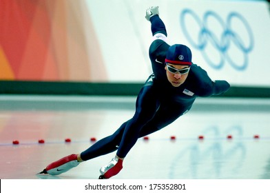 TURIN, ITALY-FEBRUARY 22, 2006: American Derek Parra competes on the Speed Ice Skating competition during the Winter Olympic Games of Turin 2006.