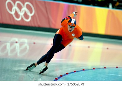 TURIN, ITALY-FEBRUARY 25, 2006: Dutch athlete competes on the Speed Ice Skating competition during the Winter Olympic Games of Turin 2006.