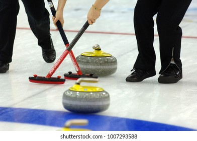 TURIN, ITALY-MARCH 28, 2006: curling match during the Winter Olympic Games of Turin 2006, in Turin.