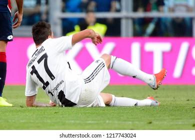 TURIN - OCT 20, 2018: Mario Mandzukic is hurt on the grass.  Juventus F.C. - Genoa C.F.C. Alliaz Stadium. Italian league Serie A.