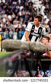 TURIN - OCT 20, 2018: Mario Mandzukic. is out of the field  Juventus F.C. - Genoa C.F.C. Alliaz Stadium. Italian league Serie A.