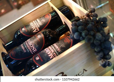 "Turin, Piedmont, Italy. -10/26/2009- Fair ""Wine show"" bottles of aged red wine Amarone Valpolicella."