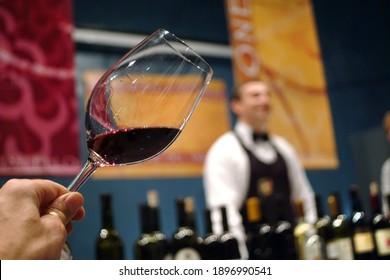 "Turin, Piedmont, Italy. -10-26-2009- Fair ""Wine show"", tasting red wine."