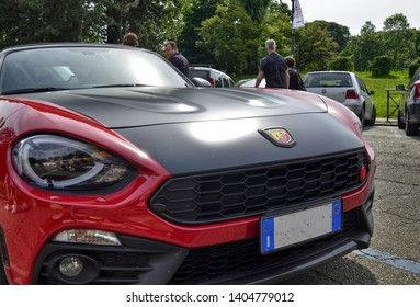 Turin, Piedmont, Italy. June 2018. At the Valentino park, the detail of the nose of an abarth 124 spider. The logo with the scorpion, symbol of the abarth house, is in plain sight.