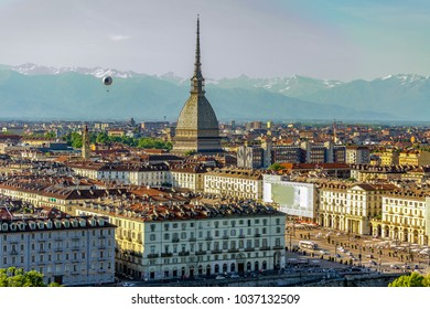 TURIN, PIEDMONT, ITALY - May 10, 2015 : Panoramic view from the Colle dei Cappuccini of Piazza Vittorio Veneto. In the background the Mole Antonelliana and a hot air balloon for tourist use.