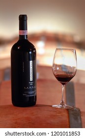 """Turin, Piedmont/Italy. -10/24/2009- The """"Wineshow Fair"""". Bottle of aged red wine Barolo."""