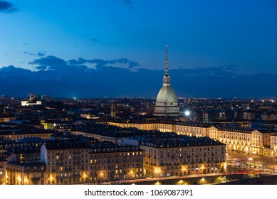 Turin skyline at dusk, Torino, Italy, panorama cityscape with the Mole Antonelliana over the city. Scenic colorful light and dramatic sky.