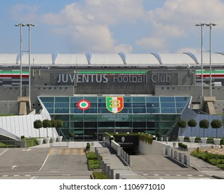 Turin, TO, Italy - August 27, 2015:Main gate of huge the Juventus Stadium with the name of the football club and the italian flag with number of cups