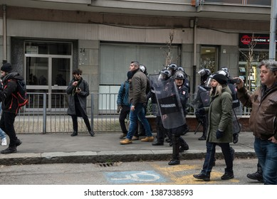 Turin,Italy-February 7, 2019: Police in riot gear guard the exterior of the building occupied by anarchists during the evacuation of the Asilo Occupato by anarchists in via Alessandria