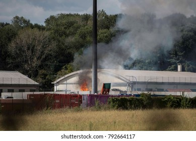 Turin,Italy-September 10,2017: Fire fighters extinguish a fire in a factory in Turin