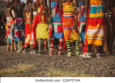 Turkana men wearing colourful traditional clothes