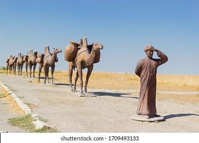Turkestan, Kazakhstan - 04 august 2019. Monument of a caravan of camels near Medieval Mausoleum of Khoja Ahmed Yasawi, Silk Road Tour