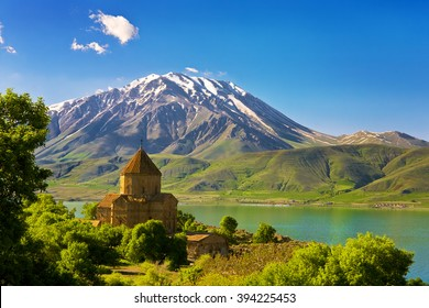 Turkey. Akdamar Island in Van Lake. The Armenian Cathedral Church of the Holy Cross (from 10th century). The dormant volcano Mount Cadir (Cadir Dagi) in the background