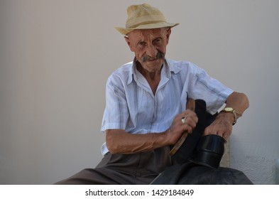 TURKEY, Ankara and June 28, 2018: Shoeshine uncle and expression