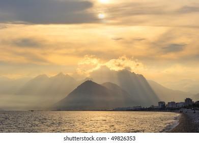 Turkey. Antalya. Mediterranean sea. Sunset view on the beach and mountains