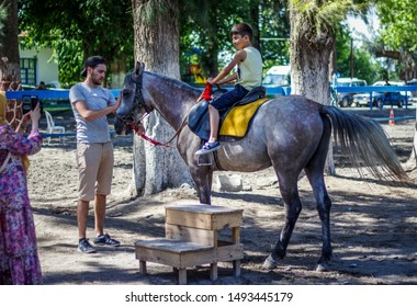 İstanbul / Turkey - August 18, 2019: People ride horses on sunday in Istanbul