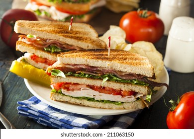 Turkey and Bacon Club Sandwich with Lettuce and Tomato