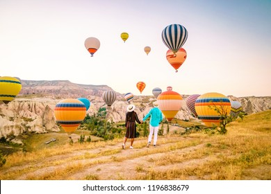 Turkey balloons Cappadocia Goreme Kapadokya , Sunrise in the mountains of Capadocia, young couple sunrise