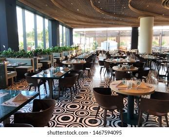 Turkey Belek, 21 July 2019: classy indoor luxury hotel resort restaurant with classic retro tiles floor and amazing wooden shaped ceiling