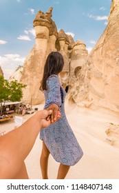 Turkey Cappadocia, Rock Formations in Pasabag Monks Valley, Cappadocia, Turkey,happy young couple on vacation in