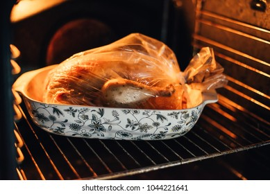 Turkey in a cooking bag in an oven