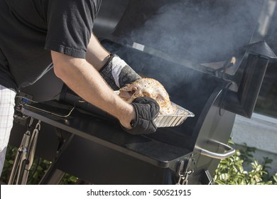 Turkey dinner being barbecued in a smoker for a family gathering