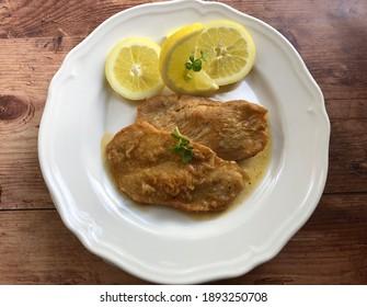 Turkey Escalope, also known als natural schnitzel with gravy and fresh lemon.