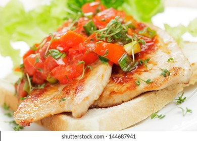 Turkey escalope with tomato on toast