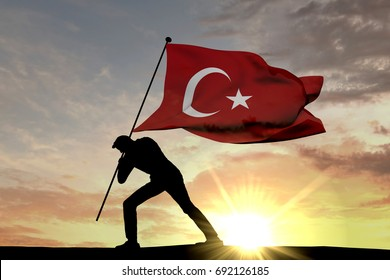 Turkey flag being pushed into the ground by a male silhouette. 3D Rendering