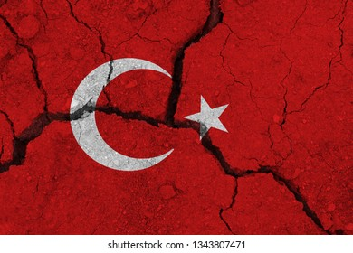 Turkey flag on the cracked earth. National flag of Turkey. Earthquake or drought concept