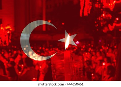 Turkey flag with people praying in background.