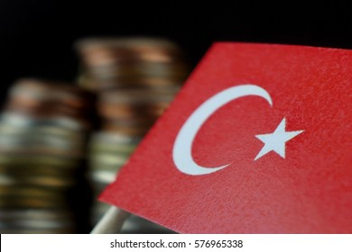Turkey flag waving with stack of money coins macro