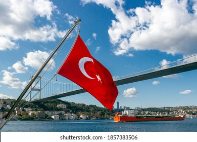 Turkey flag waving in wind over the Bosphorus strait in Istanbul, Turkey