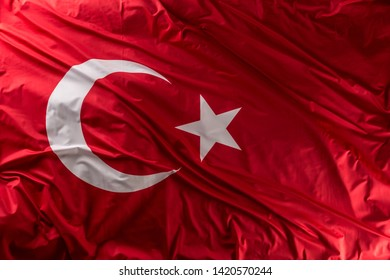 Turkey flag waving in the wind - top of view.