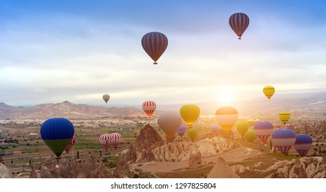 Turkey Hot air balloon Tour in sunrise mountain Cappadocia. Panoramic views of the fairy chimneys and rock formations Goreme Open Air Museum