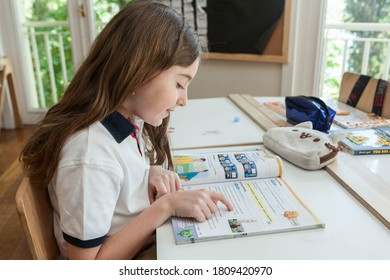 Turkey / Istanbul - 04/23/2017: a primary school student is studying, reading a book in the classroom, painting