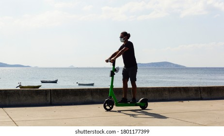 Turkey / Istanbul - 08/23/2020: young man rides a bike on the beach