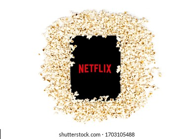 Turkey, Istanbul / April 2020 Isolated on a white background. Surrounded by popcorn grains, the Netflix logo on the Apple tablet and its screen, the global film and series platform company.