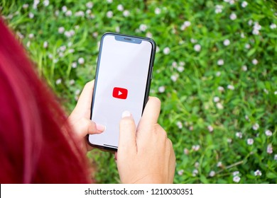 Turkey, Istanbul - September 15.2018: Hands on experience on Youtube. Reviewing Youtube application. Showing Youtube on mobilephone. Depiction of Youtube on ipone.