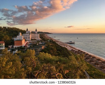 Turkey, Kemer, 28 October 2018. beautiful Turkish hotel surrounded by greenery, relict pine trees, sea, beach, dawn, clouds, hotel building with towers, the rest of the highest level. Amara Dolce Vita