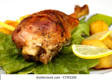 Turkey leg with potatoes and salad