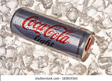 TURKEY - March 25, 2014: 250ml Light Coca-Cola Can on crushed ice. Coca-Cola is one of the world;s favorite beverages.