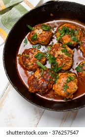 Turkey mince, cottage cheese and parsley cutlets in tomato sauce