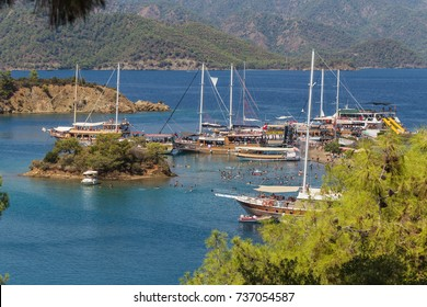 FETH?YE, TURKEY - SEPTEMBER 03, 2016: Excursion boats anchored in the bay of Yassica island, near Fethiye, in the Aegean sea, Turkey.