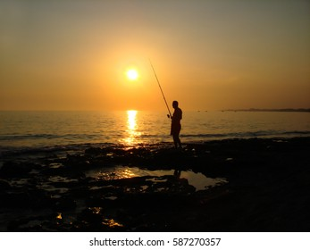 Turkey, SIDE - JULY 9, 2009: A fisherman catches a fish on the Mediterranean coast in Turkey, Side.