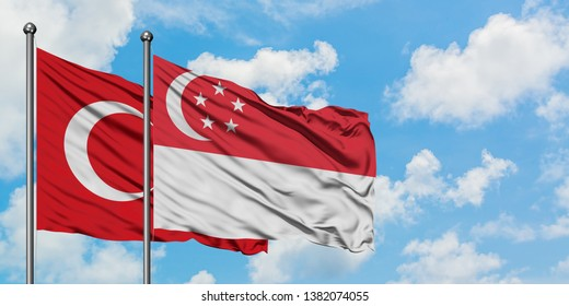 Turkey and Singapore flag waving in the wind against white cloudy blue sky together. Diplomacy concept, international relations.