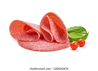 Turkey smoked salami with basil leaves and Physalia berries, close-up, isolated on a white background.
